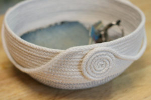 Artisan made coiled rope basket for storage and harvesting