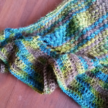 A knitted and crocheted shawlette